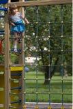 Little girl climbed high Stock Photo