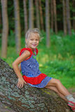 Little girl climbed on tree Royalty Free Stock Photography
