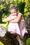 Little girl climbed up a tree Royalty Free Stock Photos