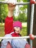 Little girl climbing Stock Photo