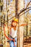 Little girl climbing in adventure park. Little girl is climbing in adventure park stock images