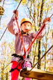 Little girl climbing in adventure park Royalty Free Stock Image