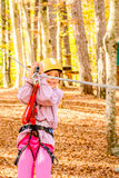 Little girl climbing in adventure park. Little girl is climbing in adventure park Royalty Free Stock Images