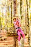 Little girl climbing in adventure park. Little girl is climbing in adventure park stock image