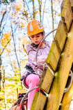 Little girl climbing in adventure park Royalty Free Stock Photography