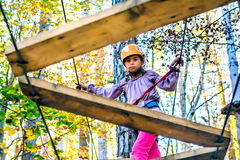 Little girl climbing in adventure park Royalty Free Stock Photos