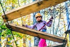 Little girl climbing in adventure park. Little girl is climbing in adventure park royalty free stock photos