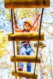 Little girl climbing in adventure park. Little girl is climbing in adventure park stock photography