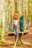 Little girl climbing in adventure park. Little girl is climbing in adventure park royalty free stock photo