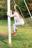 Little girl climbing on football wicket Royalty Free Stock Image