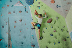 Little girl climbing in gym Royalty Free Stock Photography