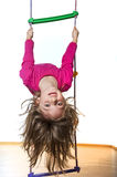 Little girl climbing on a ladder Stock Images