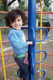 Little girl climbing the ladder climber. Royalty Free Stock Photography