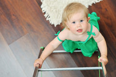 Little girl climbing on a ladder while looking up Royalty Free Stock Photos