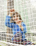 Little girl climbing in a net playground Royalty Free Stock Photo