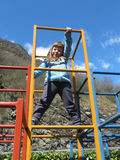little girl is climbing  in playground equipment Royalty Free Stock Photo