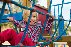 Little girl climbing the ropes Royalty Free Stock Images