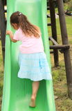 Little girl climbing a slide Royalty Free Stock Images