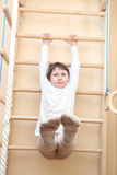 Little girl climbing Stock Photo