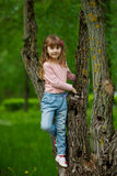Little girl climbing to the tree Royalty Free Stock Photos