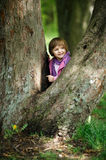 Little girl climbing tree in the park Royalty Free Stock Images