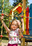 Little girl is climbing up on ladder in playground Stock Photography