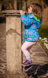 Little girl climbing up Royalty Free Stock Images