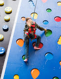 Little girl on climbing wall Royalty Free Stock Image