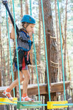 Little girl climbs on rope harness Royalty Free Stock Photography