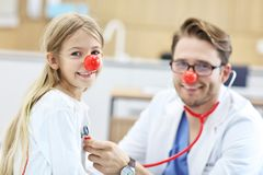 Little girl in clinic having a checkup with pediatrician royalty free stock photos