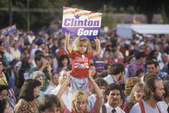 Little girl with Clinton/Gore sign stands out in the crowd during the Clinton/Gore 1992 Buscapade campaign tour in Tyler, Texas Stock Images