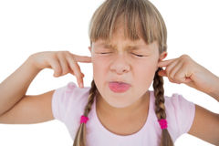 Little girl clogging her ears. On white background Royalty Free Stock Photography