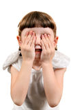Little Girl close the Eyes. Little Girl with Closed Eyes on the White Background Stock Photography