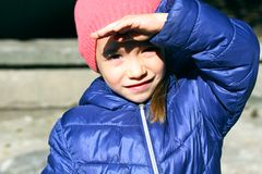 Free Little Girl Close Her Eyes With Her Hand From The Sun Royalty Free Stock Photography - 161844087