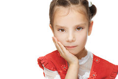 Little girl close up. Beautiful little girl close up in red dress put her hand to cheek, isolated on white background Royalty Free Stock Photos