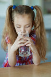 Little girl close-up drinking water Stock Photo