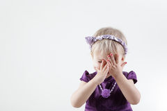 Little girl closed face Stock Image