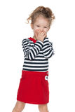 Little girl closes her mouth with her hands Royalty Free Stock Photography