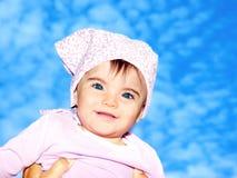 Little girl closeup portrait over sky Stock Photography