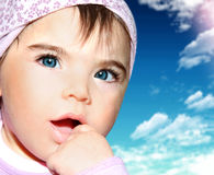 Little girl closeup portrait over sky Stock Photography