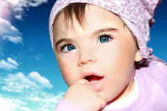 Little girl closeup portrait over sky Royalty Free Stock Image