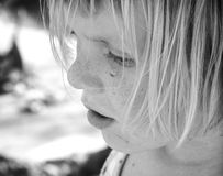 Little Girl Closeup. Portrait of a little girl with a teardrop Royalty Free Stock Photo