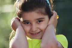 Little girl closing ears Stock Photo