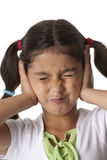 Little girl is closing her ears with her hands Royalty Free Stock Photo