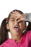 Little girl is closing her nose. With her fingers for a very unpleasant smell royalty free stock image