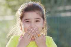 Little girl closing mouth Stock Photos