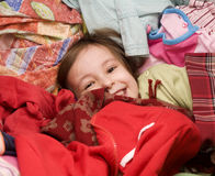 Little girl in clothes Stock Images