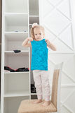 Little girl and clothes Stock Images