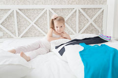Little girl and clothes Stock Photography