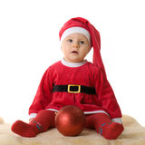 The little girl in the clothes of Santa Claus Royalty Free Stock Photography